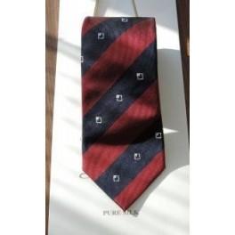 Krawat i znaczek Instytutu Misesa